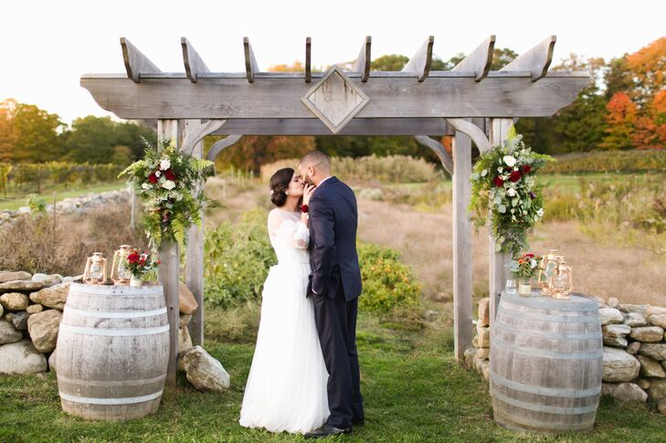 Rustic Wood Ceremony Arch and Wine Barrel Décor