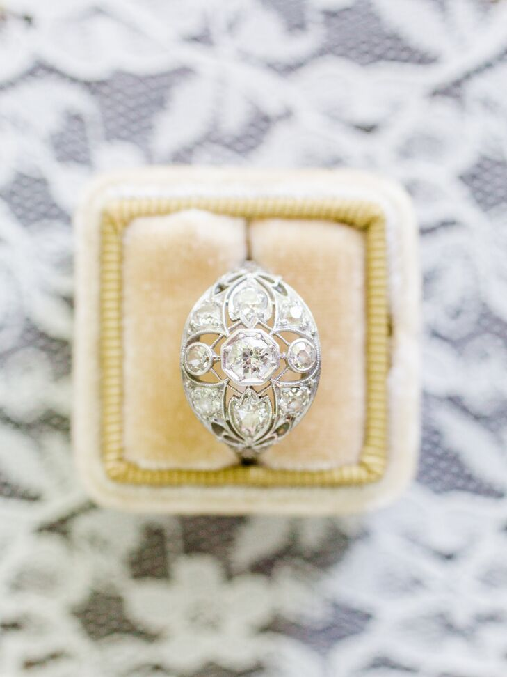 "In lieu of a traditional round-cut diamond solitaire ring, Nicole and Dor took the vintage route when it came to choosing an engagement ring. The pair spotted a striking navette style from the 1930s at Brodney Antiques in Boston and fell head over heels for its elegant old-world design. ""Dor liked that it was used,"" Nicole says."