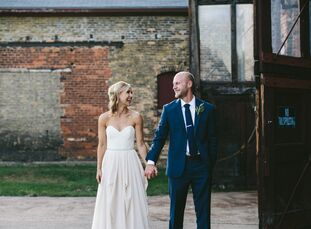 With its original brick walls, exposed beams, massive doors, natural lighting, chandeliers, wooden tables, gold chairs and stunning bridal suite, Rach