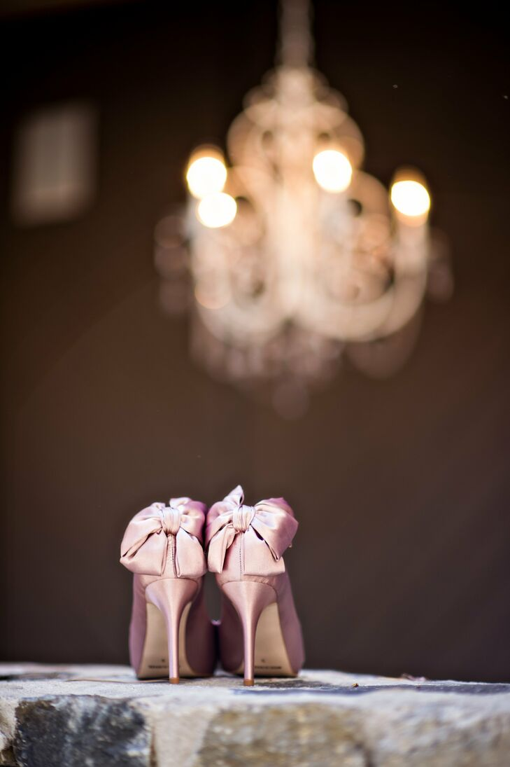 Katie's pink satin stilettos were embellished two big bows on the back of the heel.