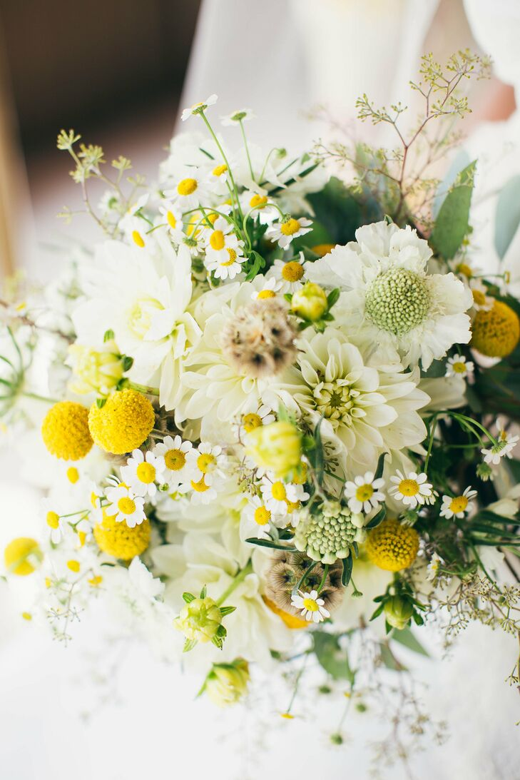 The bride carried a bright bouquet full of scabiosa, daisies and craspedia.