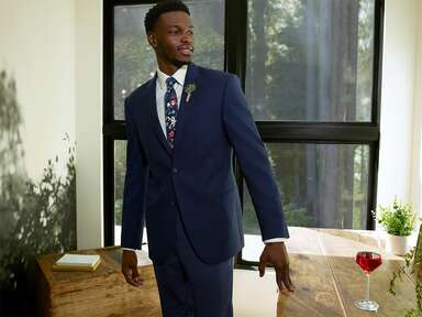 Groom to be in blue suit and floral tie
