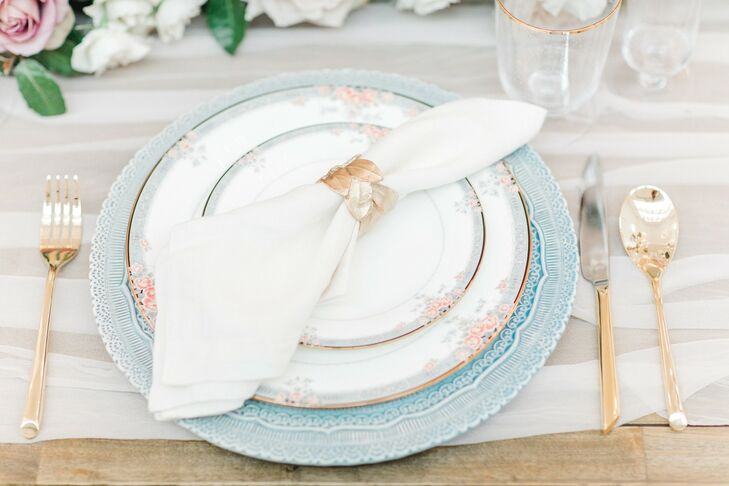 Elegant Place Setting with Patterned China and Gold Flatware