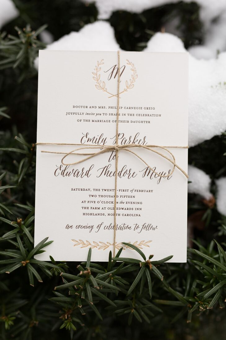 "Wanting a cohesive brand for the wedding, Emily found Paper Daisies Stationery, which created a gorgeous logo and style for the couple. The invitations were decorated with the personalized ""M"" emblem on the top in the neutral palette. The gold, bronze and white design fit the winter theme, while still being timeless and glamorous."