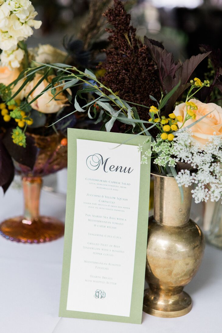 The menu was printed and displayed near floral arrangements so guests knew which course was next.