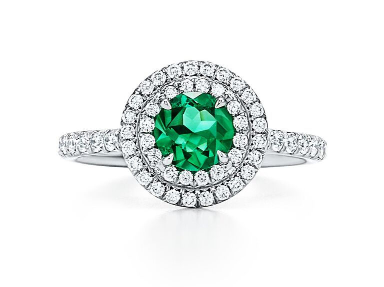Emerald engagement ring with double diamond halo