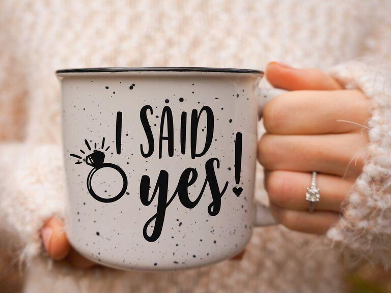 Bride holding engagement ring mug