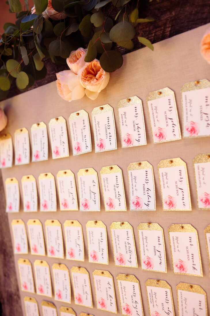 The escort cards were luggage tags, each listed with a table that corresponded with a place Nicole and Derek have traveled together.