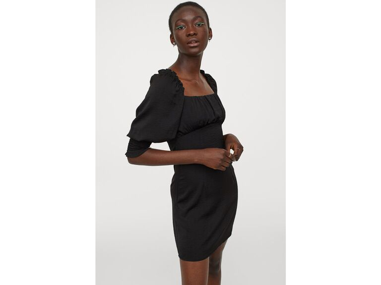 Black back laced dress with open back and puff sleeves