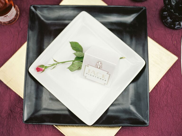 Square black and white chargers with art deco escort card