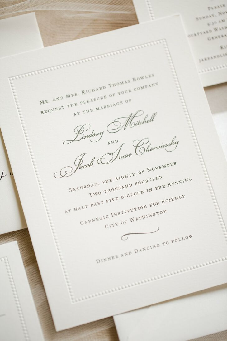 Lindsay and Jake's traditional, calligraphed wedding invitations with pearl beading borders were provided by Write For You.