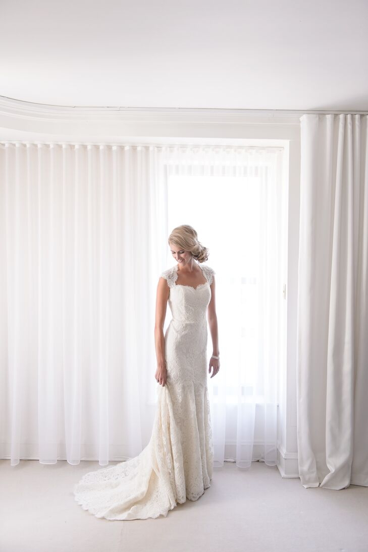 "Christina wore a white lace wedding dress by designer Anne Barge from the Mark Ingram Atelier in New York City. ""I had the most amazing consultant there,"" she says. Salon Buzz completed her classic bridal look with an intricate, twisted, sideswept bun."