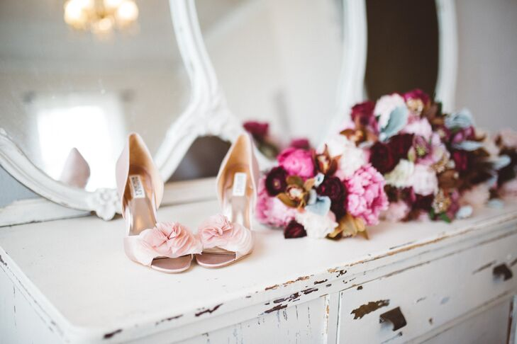 "Wanting her wedding day kicks to complement her bridesmaid dresses, Morgan opted for a pair of blush satin Badgley Mischka heels with a peep-toe silhouette and flirtatious floral embellishments. ""When I saw them, I knew I had found my shoe,"" Morgan says."