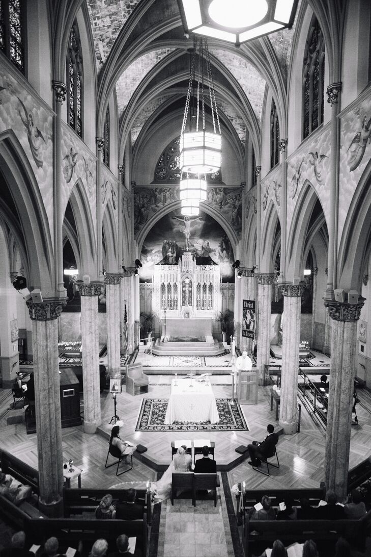 """""""We began our venue search wanting something that offered both indoor and outdoor space and something that would highlight New York City,"""" the couple says. They had their ceremony at St. Malachy's Roman Catholic Church (the Actors' Chapel) and walked to Le Parker Meridien for their reception."""