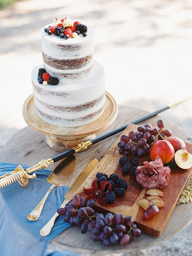Simple two-tier nearly-naked wedding cake with berries