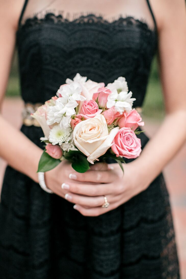 The bridesmaids carried small bouquets of pink and blush roses, white dahlias and other white flowers.