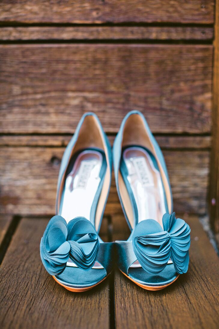 """For her """"something blue,"""" Kimberly wore a teal stain pair of peep-toe pumps with silk rosettes."""