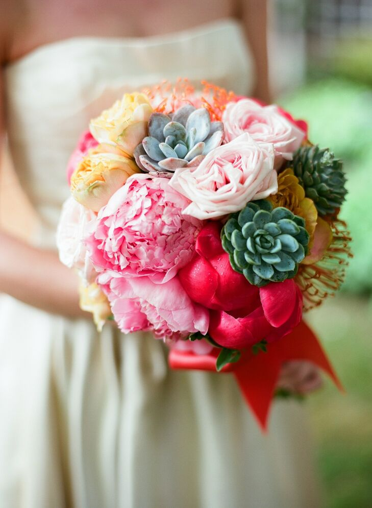 The day's color palette centered around Krissy's bouquet of peonies, roses, succulents and pincushion protea.