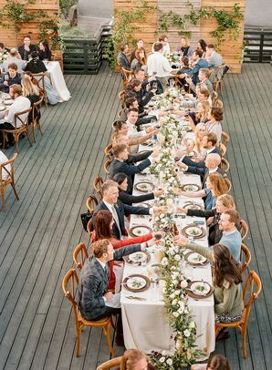 Wedding Guests Toasting During Dinner at Timber Cove Resort