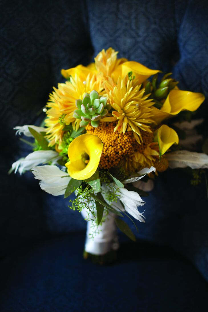 Yellow dahlias, calla lilies and craspedia made up Amy's textured bouquet.