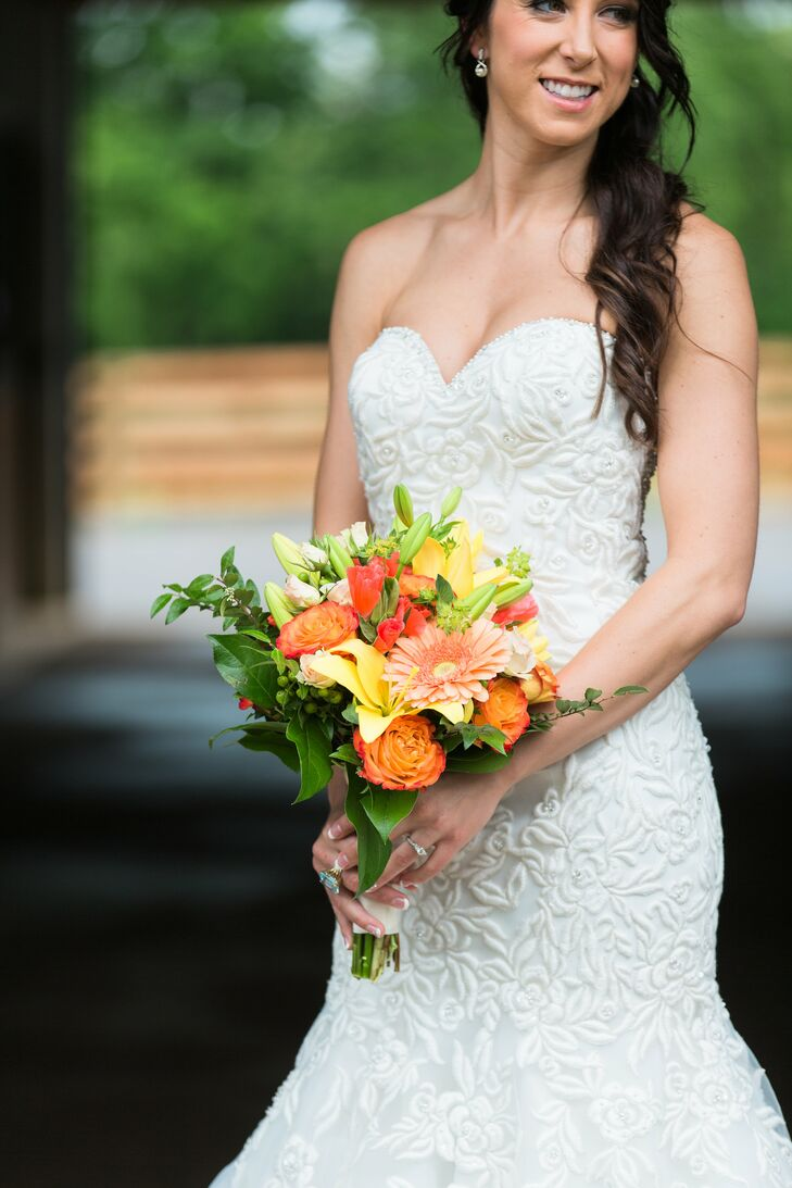 Early in their relationship, Brandon gave Kelsey a bouquet of circus roses. She's loved them ever since, so she knew she wanted them in her bouquet. Carol Lynn Events also included lilies,