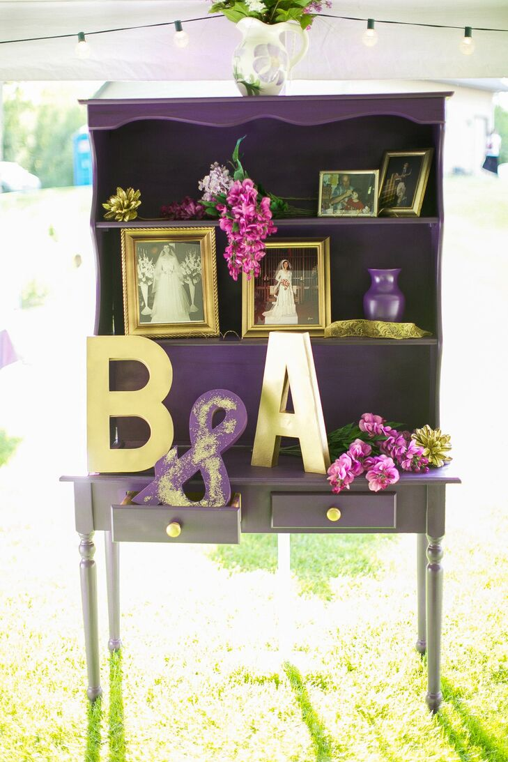 This hand-painted dresser showcased photographs of Anna's grandmother and mother in the same wedding dress Anna wore. Pops of fuchsia and gold were introduced with frames, glitter, letters and flowers on the dresser.