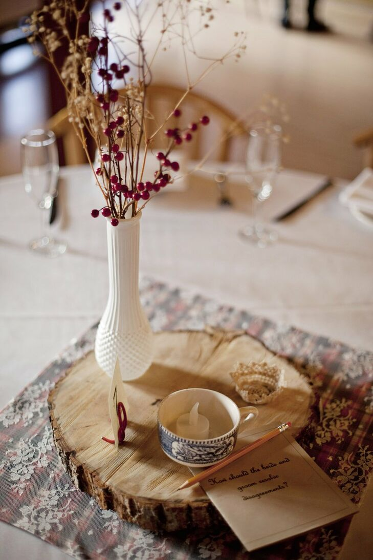 The rustic centerpieces consisted of white vases filled with dried flowers and teacups arranged on top of wood slices. Lacy table runners added a feminine, vintage flair.