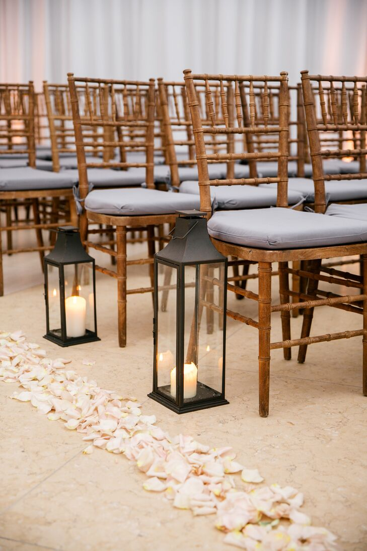 Brown Chiavari Chairs, Candle Lanterns and Rose Petals at Modern Ceremony