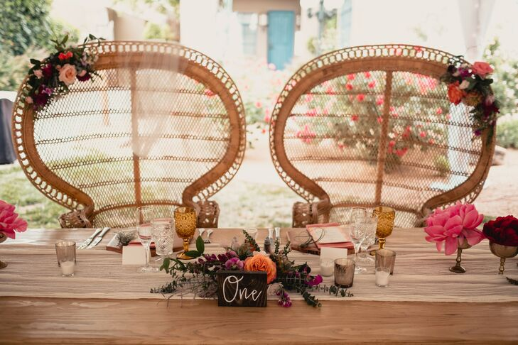 Bohemian Peacock Sweetheart Chairs at Wood Farm Table