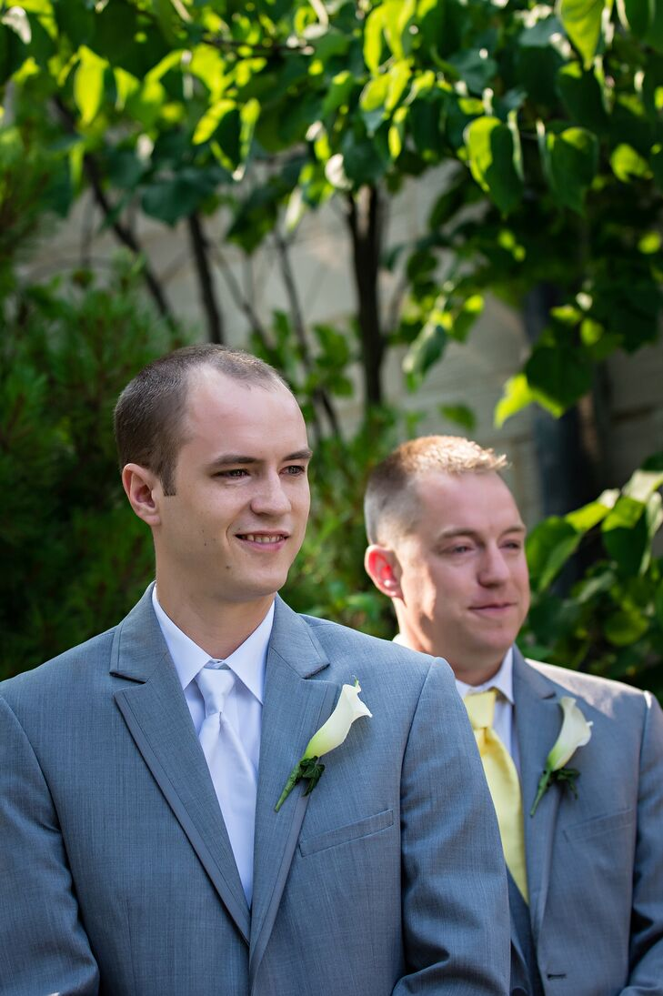 Jeremy and his groomsmen wore matching light gray suits with traditional ties--white for the groom, and pale yellow for the groomsmen. They each wore a single calla lily stem as a sleek boutonniere.
