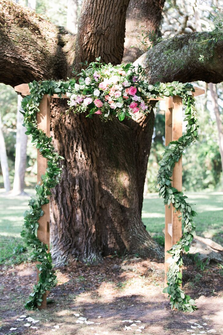 Eucalyptus and Rose Garland Draped Wedding Arch
