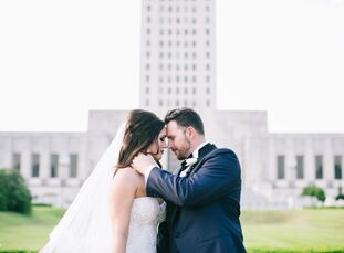 The landmarks of downtown Baton Rouge, Louisiana, inspired the wedding between Dawn Carrier (26 and a project manager) and Carson Narcomey (30 and a f