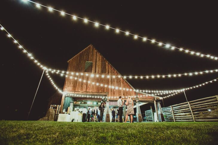 Lights were strung above the reception space outside of the barn at  Brasada Ranch.