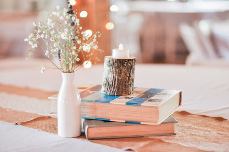 An eclectic mix of centerpieces, including vintage books, jars and candles filled with lavender, wheat and baby's breath added to the vintage vibe at Sisterdale Dancehall in Boerne, Texas.