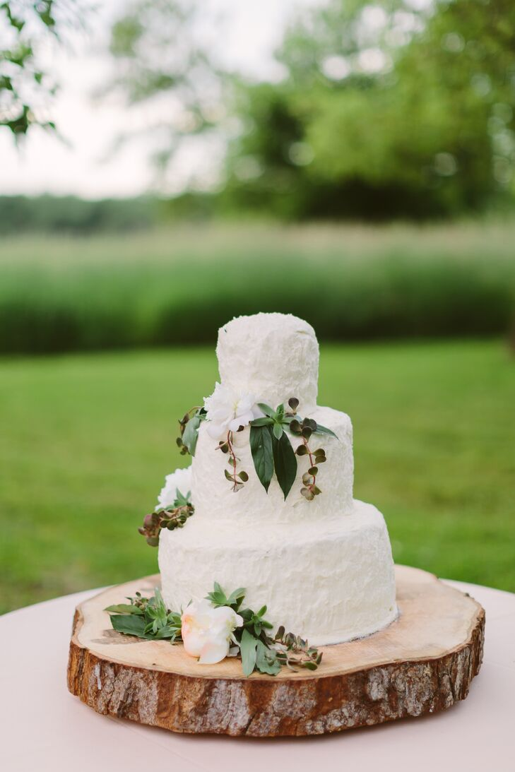 Ivory Cake On Wooden Slab Stand