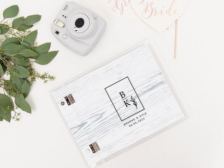 Elegant rustic wedding shower guest book with polaroid camera