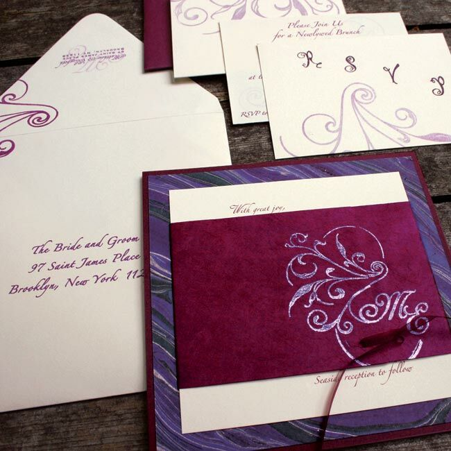 After checking out numerous paper stores in New York City, the couple found the perfect combo of papers for their invitations. Plum-colored backing, hand-painted paper, and a cranberry papyrus wrap provided the sophisticated look they craved. A swirling flourish motif, reminiscent of both vines and the ocean, completed the stylish invites.