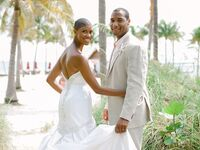married couple during a beach wedding ceremony at Tranquility Bay in Marathon, Florida
