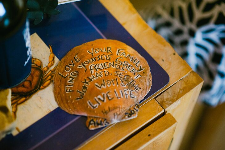 Nautical elements like this clam shell with inspirational words decorated the beach ceremony and reception.