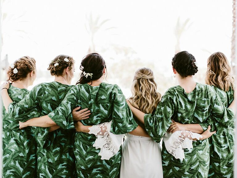Bride with bridesmaids in matching robes.