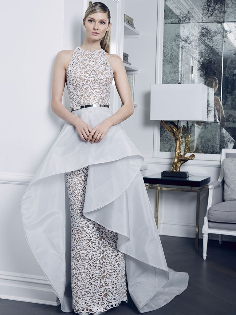Romona Keveza Collection Fall 2018 wedding dress with a ruffled skirt overlay and silver belt