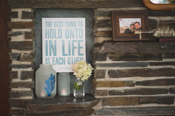 Small signs with inspiring messages of love were hung throughout The Captain's House reception venue.