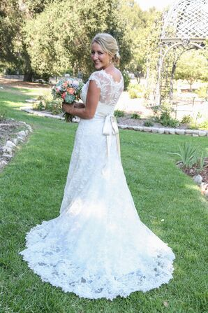 White Wedding Dress With Bouquet