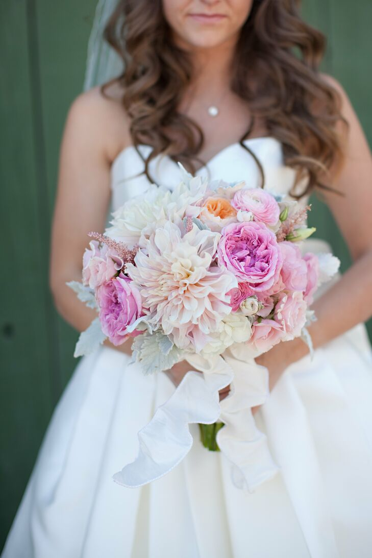 The pink bridal bouquet featured an arrangement of dahlias, ranunculuses and garden roses.