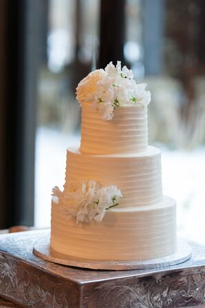 White Lisianthus-Topped Textured White Buttercream Wedding Cake