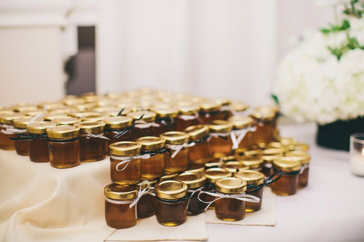 Honey in small jars from Christina's uncle's family farm served as wedding favors. A simple bow around the lid was a sweet touch for the DIY favor.