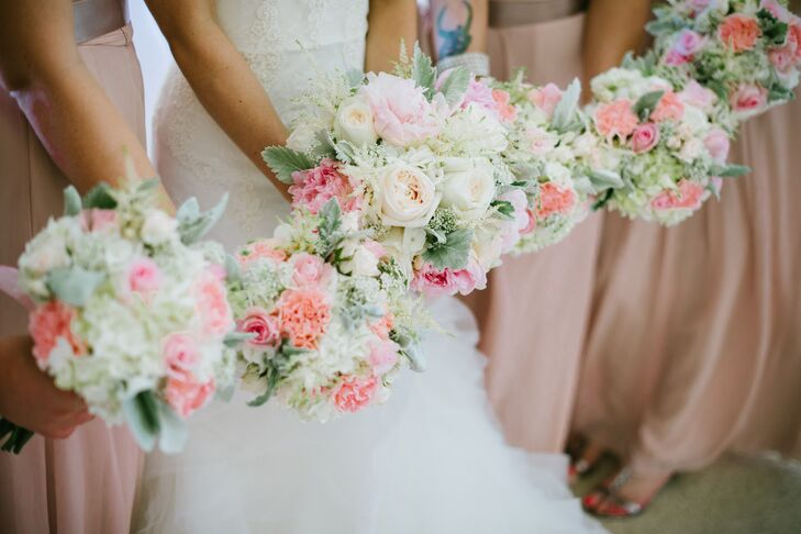 """""""Bridesmaids wore floor length blush chiffon dresses with a rushed bodice and sweetheart neckline. Each bridesmaid wore a pearl necklace."""""""