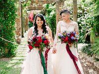 Newlyweds under botanical archway in Florida