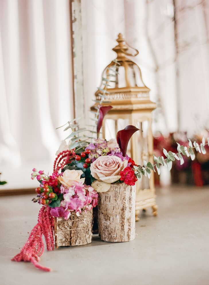The chairs were mahogany, keeping with the deep/rich color scheme, and the aisle was lined with gold lanterns boasting flowers in a deep, rich color scheme that celebrated the arrival of fall and the spirit of New Orleans.
