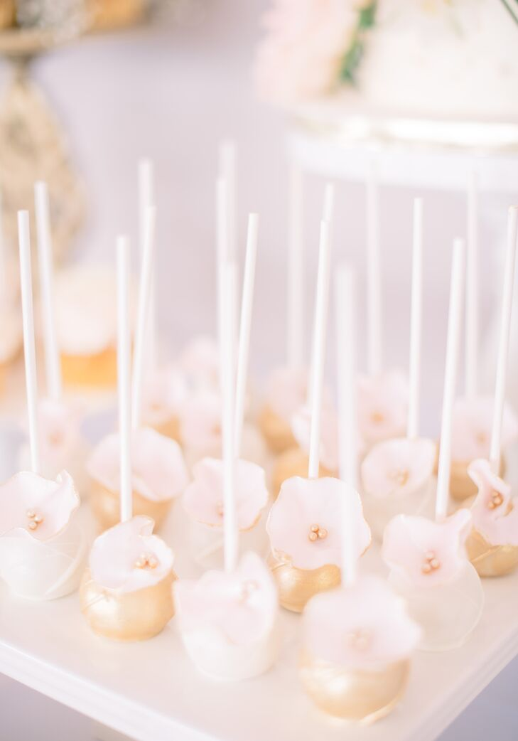 The dessert display was a bona fide work of art, overflowing with decadent after-dinner delights, such as ivory and gold cake balls decorated with blush sugar flowers.